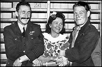 BNPS.co.uk (01202 558833)<br /> Pic: Pen&amp;Sword/BNPS<br /> <br /> With &lsquo;Pop&rsquo; Pullin and the Swedish film star Marguerite Viby at Goteborg in September 1944, after he had been repatriated.<br /> <br /> he remarkable story of a British hero double amputee pilot who took to the skies during the Second World War has come to light.<br /> <br /> Flight Lieutenant Colin Hodgkinson lost his legs in a horror crash in a Tiger Moth in May 1939 but went on to emulate Sir Douglas Bader and fly Spitfires in the Royal Air Force.<br /> <br /> He even endured a spell in the Great Escape prisoner of war camp after being shot down over France in 1943 but rejoined the RAF after being repatriated.<br /> <br /> The pair were the only two British double amputee pilots to fly during the war - yet while Bader, rightly, is a household name, Flt Lt Hodgkinson's exploits have been largely forgotten.<br /> <br /> This has prompted historian Mark Hillier to publish Flt Lt Hodgkinson's autobiography 60 years after it was penned which he hopes will shine some limelight on a 'special' man whose courage he says was every bit as great as Baders'.<br /> <br /> Best Foot Forward, by Colin Hodgkinson, is published by Pen &amp; Sword.