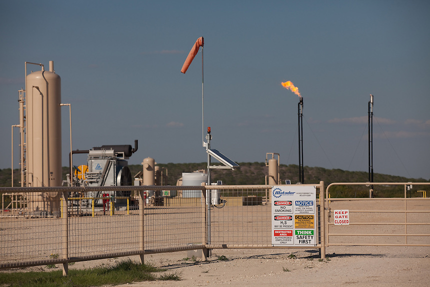 KARNES COUNTY, TX - SEPTEMBER 25, 2013: Detail of an entrance to a well site, with a sign warning of H2S, which is Hydrogen Sulfide gas. A wind sock is used to indicate wind direction in case of a poison gas emergency. CREDIT: Lance Rosenfield/Prime