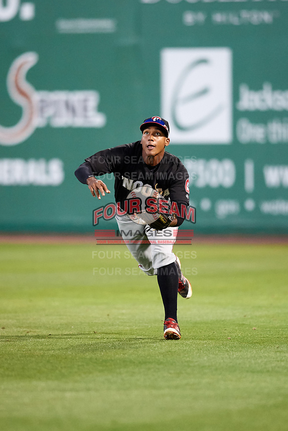 Chattanooga Lookouts right fielder Edgar Corcino (11) tracks a fly ball during a game against the Jackson Generals on April 27, 2017 at The Ballpark at Jackson in Jackson, Tennessee.  Chattanooga defeated Jackson 5-4.  (Mike Janes/Four Seam Images)