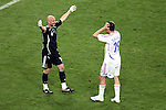 05 July 2006: Goalkeeper Fabien Barthez (FRA) (left) prepares to hug a disbelieving Willy Sagnol (FRA) (right) after the France win. France defeated Portugal 1-0 at the Allianz Arena in Munich, Germany in match 62, the second semifinal game, in the 2006 FIFA World Cup.