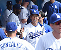 Kenta Maeda (Dodgers),<br /> MARCH 5, 2016 - MLB :<br /> Kenta Maeda of the Los Angeles Dodgers high fives teammates in the dugout before a spring training baseball game against the Arizona Diamondbacks at Camelback Ranch-Glendale in Phoenix, Arizona, United States. (Photo by AFLO)