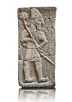 Late Hittite (Aramaean)  Basalt relief sculpture of a Male with Axe  from 9th Cent B.C, excavated from the west side of the citadel gate of Sam'al (Hittite: Yadiya) located at Zincirli Höyük in the Anti-Taurus Mountains of modern Turkey's Gaziantep Province. Istanbul Archaeological Museum  Inv No. 7727.