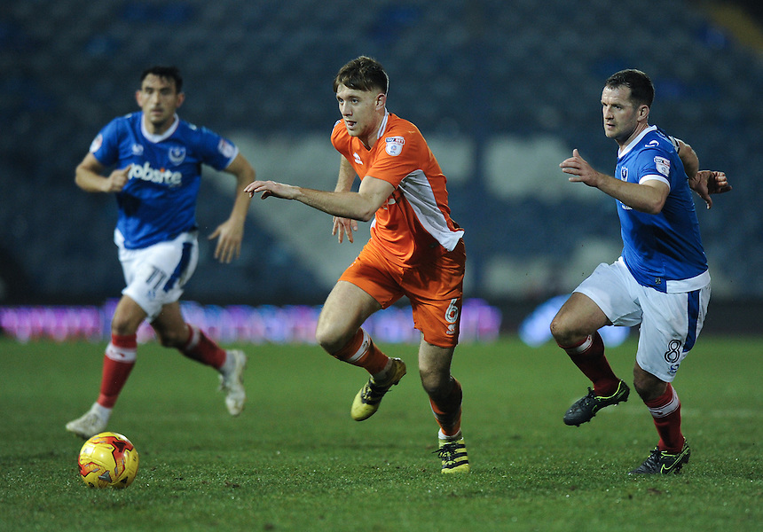 Blackpool's Will Aimson holds off the challenge fromPortsmouth's Michael Doyle<br /> <br /> Photographer Ashley Western/CameraSport<br /> <br /> The EFL Sky Bet League Two - Portsmouth v Blackpool  - Tuesday 14th February 2017 - Fratton Park - Portsmouth<br /> <br /> World Copyright &copy; 2017 CameraSport. All rights reserved. 43 Linden Ave. Countesthorpe. Leicester. England. LE8 5PG - Tel: +44 (0) 116 277 4147 - admin@camerasport.com - www.camerasport.com