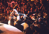 Legendary rock star and icon Bruce Springsteen is held up by fans as he crowd surfs during a performance in Worcester,  MA.