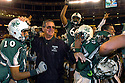 Oceanside High School's head coach John Carroll celebrates with his team after their win over Helix High School for the CIF Division II championship in 2006.  photo for the North County Times