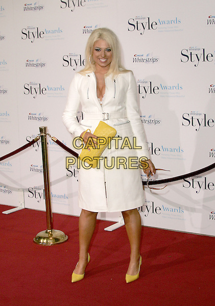 TAWNY.The 1st Annual Crest White Strips Style Awards held at The Beverly Hills Hotel in Beverly Hills, California .June 16,2004.full length, full-length, white coat, jacket, yellow purse, bag, yellow shoes, Donna Karan  .www.capitalpictures.com.sales@capitalpictures.com.©Capital Pictures