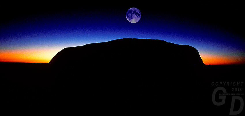 Ayers Rock at sunrise and moon. Uluru National Park, Central Australia