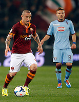 Calcio, Serie A: Roma vs Torino. Roma, stadio Olimpico, 25 marzo 2014.<br /> AS Roma midfielder Radja Nainggolan, of Belgium, in action past Torino forward Ciro Immobile, right, during the Italian Serie A football match between AS Roma and Torino at Rome's Olympic stadium, 25 March 2014.<br /> UPDATE IMAGES PRESS/Riccardo De Luca