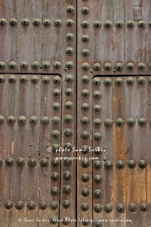 Typical Andalusian-style wooden studded door, Andalusia, Spain.