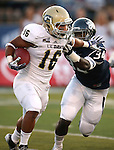 UC Davis runningback Tavior Mowry scrambles from Nevada defender Travis WIlson during the first half of a college football game in Reno, Nev., on Saturday, Sept. 7, 2013. Nevada won 36-7. (AP Photo/Cathleen Allison)
