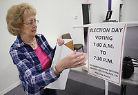 NWA Democrat-Gazette/DAVID GOTTSCHALK Judy Faulkner, Washington County Election Official, posts signage Monday, November 5, 2018, at the Main Street Baptist Voting Center in Farmington. The polling place, one of more than 40 in Washington County, is open from 7:30 a.m. to 7:30 p.m. today for the general election.