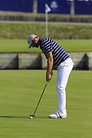 Dustin Johnson Team USA putts to win the match on the 15th green during Friday's Fourball Matches at the 2018 Ryder Cup, Le Golf National, Iles-de-France, France. 28/09/2018.<br /> Picture Eoin Clarke / Golffile.ie<br /> <br /> All photo usage must carry mandatory copyright credit (© Golffile | Eoin Clarke)