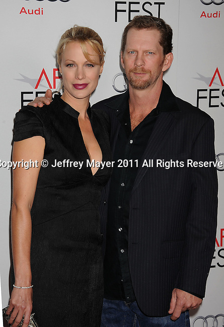 """HOLLYWOOD, CA - NOVEMBER 03: Alison Eastwood and Ash Adams attend AFI Fest 2011 Opening Night Gala World Premiere Of """"J. Edgar""""at Grauman's Chinese Theatre on November 3, 2011 in Hollywood, California."""