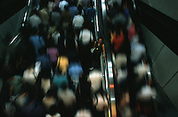QS03Stock012 20010811 SHANGHAI, CHINA:.A woman finds herself unable to manuver facing the onslaught of commuters at thw People's Square Metro Station during rush hour in Shanghai, China 11 August 2001. The subway lines have been immensely successful since their completion, easing the otherwise choked road traffic and long commuting hours.Photo By: Qilai Shen