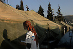 A woman prays in a tent compound for new families that have just moved-in, at the Israeli settlement of Sa-Nur, West Bank.<br /> Thousands of settlers gathered in Sa-Nur that day, to welcome and assist 13 settler families, which recently moved-in to the settlement, some 2 months before Sa-Nur is due to be evacuated as part of Israel's pullout from Gaza and the northern West Bank.