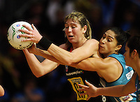 Thuinderbirds goal defence Mo'onia Gerrard tries to get the ball off Irene Van Dyk during the ANZ Netball Championship match between the Waikato Bay of Plenty Magic and Adelaide Thunderbirds, Mystery Creek Events Centre, Hamilton, New Zealand on Sunday 19 July 2009. Photo: Dave Lintott / lintottphoto.co.nz