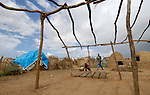 A newly arrived family builds a shelter in the Hassa Hissa Camp for internally displaced persons, outside Zalingei in Sudan's violence-torn Darfur region.