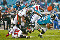 December 11, 2011:  Jacksonville Jaguars running back Maurice Jones-Drew (32) dives to the goal line during second half action between the Jacksonville Jaguars and the Tampa Bay Buccaneers played at EverBank Field in Jacksonville, Florida.  Jacksonville defeated Tamp Bay 41-14.........
