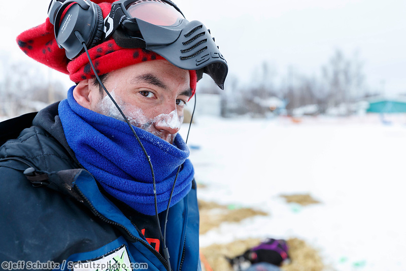 Ryan Redington at the Huslia checkpoint during the 2017 Iditarod on Saturday morning March 11, 2017.<br /> <br /> Photo by Jeff Schultz/SchultzPhoto.com  (C) 2017  ALL RIGHTS RESERVED