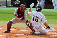 HOUSTON, TEXAS - Feb. 19, 2011: Zack Jones of Stanford attempts to tag a Rice runner attempting to score during the game at Rice. Rice defeated Stanford 7-1.