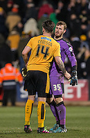 Goalkeeper Will Norris of Cambridge United congratulates Josh Coulson of Cambridge United at the final whistle during the Sky Bet League 2 match between Cambridge United and Wycombe Wanderers at the R Costings Abbey Stadium, Cambridge, England on 1 March 2016. Photo by Andy Rowland / PRiME Media Images.