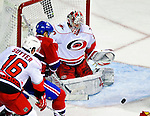31 March 2010: Carolina Hurricanes' goaltender Cam Ward makes a third period save against the Montreal Canadiens at the Bell Centre in Montreal, Quebec, Canada. The Hurricanes defeated the Canadiens 2-1 in their last meeting of the regular season. Mandatory Credit: Ed Wolfstein Photo