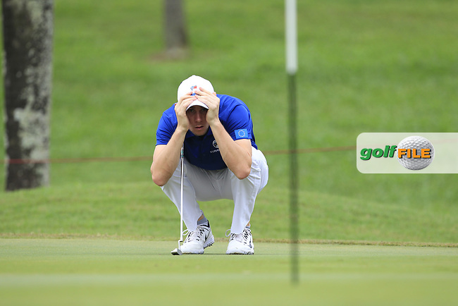Thomas Pieters (Europe) on the 1st green during the Singles Matches of the Eurasia Cup at Glenmarie Golf and Country Club on the Sunday 14th January 2018.<br /> Picture:  Thos Caffrey / www.golffile.ie