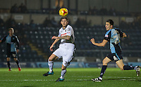 Goal scorer Jon Stead of Notts County controls the ball under pressure from Luke O'Nien of Wycombe Wanderers during the Sky Bet League 2 match between Wycombe Wanderers and Notts County at Adams Park, High Wycombe, England on 15 December 2015. Photo by Andy Rowland.