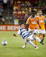 FC Dallas defender Drew Moor (2) goes down in front of Houston Dynamo forward Kei Kamara (10).  Houston Dynamo defeated FC Dallas 1-0 at Robertson Stadium in Houston, TX on May 9, 2009