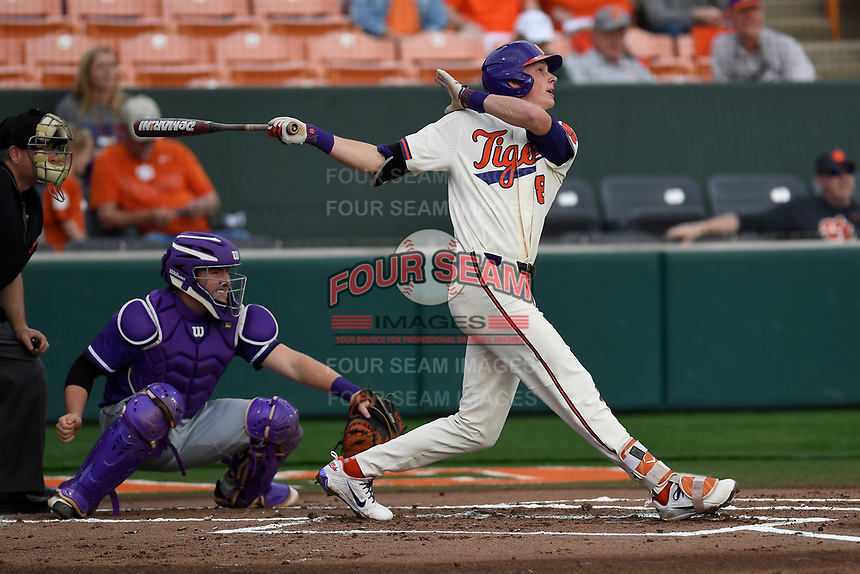 Shortstop Logan Davidson (8) of the Clemson Tigers bats in a game against the Furman Paladins on Tuesday, February 20, 2018, at Doug Kingsmore Stadium in Clemson, South Carolina. The catcher is Logan Taplett; the umpire is Darion Padgett. Clemson won, 12-4. (Tom Priddy/Four Seam Images)