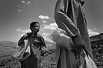 KHAK-E-JABAR DISTRICT, AFGHANISTAN - MAY 15. .(from left) 8-year-old Zahedullah and 12-year-old Safiullah look for scrap metal and shrapnel from exploded anti-personel mines outside their village in Khak-e-Jabar district. The areas in and around the capital Kabul were heavily mined during the Soviet invasion of Afghanistan during the 1980's. (Javier Manzano / For The Washington Post). ..