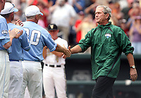 Former President George W. Bush greets UNC Head Coach Mike Fox before throwing out the ceremonial first pitch to open the 2011 College World Series. Vanderbilt beat UNC 7-3 in the first College World Series game played at TD Ameritrade Park Omaha. (Photo by Michelle Bishop)..