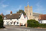 The Kings Head Inn and village church, Orford, Suffolk, England, UK