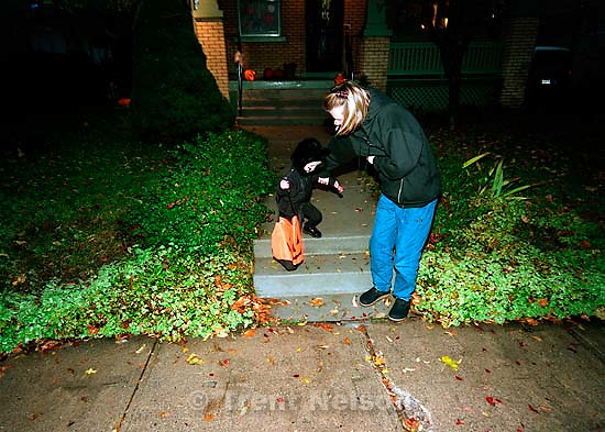 Noah Nelson in his black cat Halloween costume. Laura Nelson helping.<br />