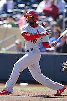 Xavier Scruggs #16 of the Memphis Redbirds swings against the Omaha Storm Chasers at Werner Park on April 9, 2014 in Omaha, Nebraska. The Storm Chasers beat the Redbirds 20-3.   (Dennis Hubbard/Four Seam Images)