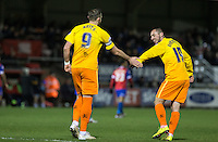 Michael Harriman of Wycombe Wanderers congratulates goal scorer Paul Hayes (9) of Wycombe Wanderers during the Sky Bet League 2 match between Dagenham and Redbridge and Wycombe Wanderers at the London Borough of Barking and Dagenham Stadium, London, England on 9 February 2016. Photo by Andy Rowland.
