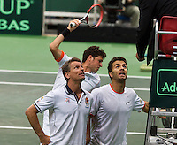 01-02-14,Czech Republic, Ostrava, Cez Arena, Davis Cup Czech Republic vs Netherlands,Robin Haase(NED) gets irritated and hits the net and Jean-Julien Rojer(NED) (R) and captain Jan Siemerink discus with the umpire  <br /> Photo: Henk Koster