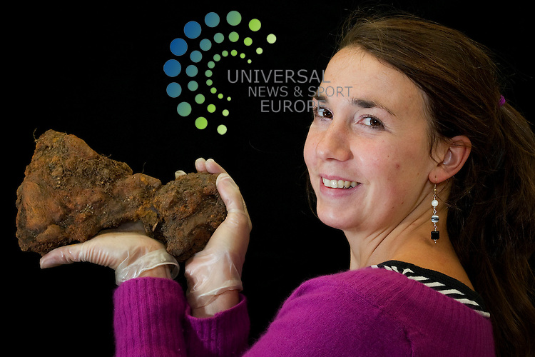 Co-director Helena Gray with 9th - 10th century AD Viking artefacts found at Ardnamurchan, the only well preserved mainland Viking boat burial site on the mainland, Edinburgh, Scotland, 18th October, 2011. Pictured Viking Axe made of Iron..Picture:Scott Taylor Universal News And Sport (Europe) .All pictures must be credited to www.universalnewsandsport.com. (Office)0844 884 51 22.
