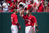 Evan Edwards (18) of the North Carolina State Wolfpack celebrates with teammate Brock Deatherage (13) after hitting a home run against the Army Black Knights at Doak Field at Dail Park on June 3, 2018 in Raleigh, North Carolina. The Wolfpack defeated the Black Knights 11-1. (Brian Westerholt/Four Seam Images)