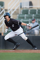 Jameson Fisher (11) of the Kannapolis Intimidators throws his bat after laying down a bunt against the Lakewood BlueClaws at Kannapolis Intimidators Stadium on April 6, 2017 in Kannapolis, North Carolina.  The BlueClaws defeated the Intimidators 7-5.  (Brian Westerholt/Four Seam Images)