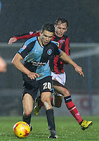 Luke O'Nien of Wycombe Wanderers holds off Jamie Devitt of Morecambe during the Sky Bet League 2 match between Wycombe Wanderers and Morecambe at Adams Park, High Wycombe, England on 2 January 2016. Photo by Andy Rowland / PRiME Media Images