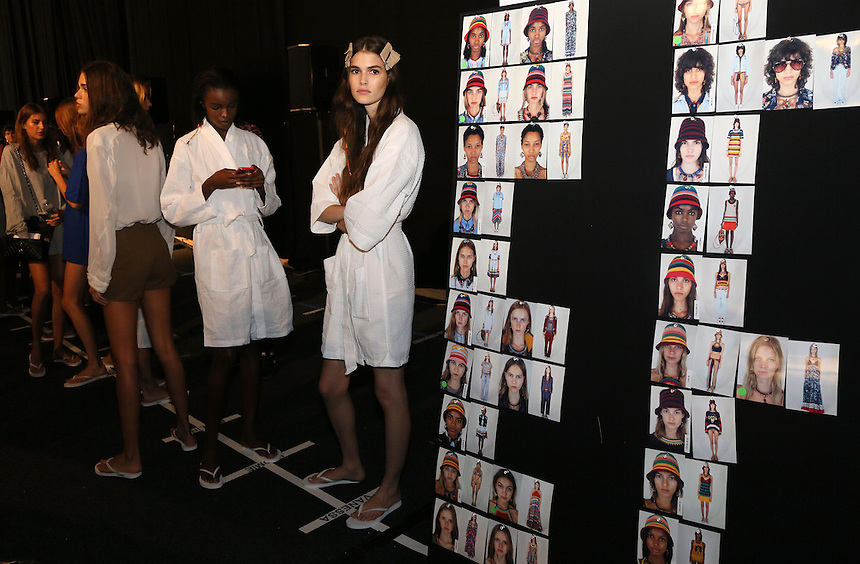Models in gowns wait backstage before dressing for the Tommy Hilfiger presentation during New York Fashion Week in New York, Monday, September 14, 2015. AFP PHOTO/TREVOR COLLENS