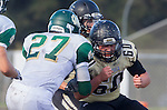 Palos Verdes, CA 10/25/13 - Carlo Merola (Peninsula #60) in action during the Mira Costa vs Peninsula varsity football game at Palos Verdes Peninsula High School.