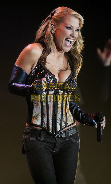 ANASTACIA.Live in Concert.European Tour 2004, Ahoy Stadium.February 26th, 2005.music corset gloves half length cleavage dancing mouth open.www.capitalpictures.com.sales@capitalpictures.com.©Capital Pictures.