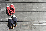 Two pairs of shoes on pier in Watsons Bay, NSW, Australia