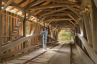 This 97 foot burr truss covered bridge has several names.  The most mommon is Gristmill Bridge bercause there is a grist mill just down river.  The other names are the Canyon Bridge, The Scott Bridge and the Alden Bryan Bridge.  You should call the Jeff Town Clerk.  The Bridge is built over the Brewster River and is just off Rt 108. No one knows for sure when it was built, but 1870 is a good guess.  The bridge was rehabed in 2004..