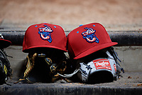 A pair of Jacksonville Jumbo Shrimp hats sit on gloves during a game against the Mobile BayBears on April 14, 2018 at Baseball Grounds of Jacksonville in Jacksonville, Florida.  Mobile defeated Jacksonville 13-3.  (Mike Janes/Four Seam Images)