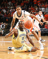 Georgia Tech's Zachery Peacock(35) loses control of the ball in front of Virginia defenders Sylven landesberg, behind, and Sammy Zeglinski, right, during an ACC college basketball game Wednesday Jan. 13, 2010 in Charlottesville, Va. Virginia won 82-75.  ( Photo/Andrew Shurtleff)