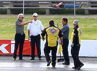 May30, 2014; Englishtown, NJ, USA; NHRA official Graham Light (white shirt) talks with team owner Alan Johnson (left) during the Summernationals at Raceway Park. Mandatory Credit: Mark J. Rebilas-