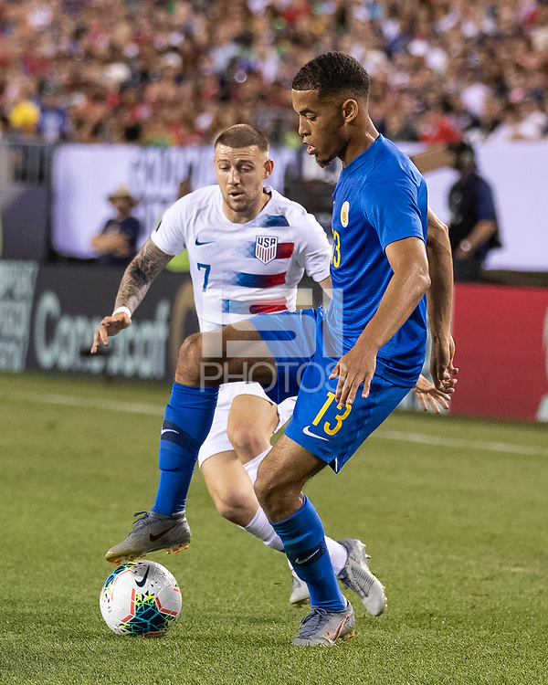 PHILADELPHIA, PA - JUNE 30: Paul Arriola #7 takes on Jurien Gaari #13 during a game between Curaçao and USMNT at Lincoln Financial Field on June 30, 2019 in Philadelphia, Pennsylvania.